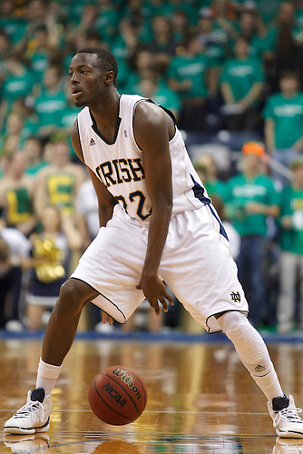 Notre Dame guard Jerian Grant (#22) dribbles the ball in second half action of NCAA Men's basketball game between Marquette and Notre Dame.  The Notre Dame Fighting Irish defeated the Marquette Golden Eagles 76-59 in game at Purcell Pavilion at the Joyce Center in South Bend, Indiana.
