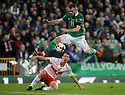 BELFAST, NORTHERN IRELAND - Nov 09: Northern Ireland's Chris Brunt leaps overs Switzerland's Stephan Lichtsteiner during the 2018 FIFA World Cup play-offs first leg soccer match at Windsor Park, in Belfast, Northern Ireland November 9, 2017. Photo/Paul McErlane