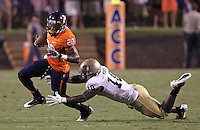 Sept. 3, 2011 - Charlottesville, Virginia - USA; Virginia Cavaliers wide receiver Tim Smith (20) runs past William & Mary Tribe linebacker Jabrel Mines (10) during an NCAA football game at Scott Stadium. Virginia won 40-3. (Credit Image: © Andrew Shurtleff