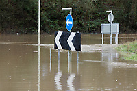 Pictured: A road sign is partially submerged in water by a roundabout on Caerphilly Road in Nantgarw, Wales, UK. Sunday 16 February 2020<br /> Re: Residents from Oxford Street in the village of Nantgarw had to be evacuated in inflatable boats by the Fire Service after rover Taff burst its banks in south Wales, UK.