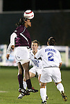 Boston College's Kia McNeill (l) jumps over Duke's Heidi Hollenbeck (10) and Carmen Bognanno (2) to head the ball on Wednesday, November 2nd, 2005 at SAS Stadium in Cary, North Carolina. The Duke University Blue Devils defeated the Boston College Eagles 2-0 during their Atlantic Coast Conference Tournament Quarterfinal game.