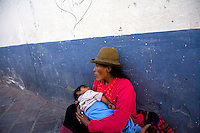 MOTHER HANDLES NEWBORN IN ALLEY IN CUZCO, PERU