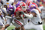 Tennessee Tech Golden Eagles defense tackles Wisconsin Badgers running back James White (20) during an NCAA football game  Saturday, September 7, 2013, in Madison, Wis. The Badgers won 48-0.  (Photo by David Stluka)