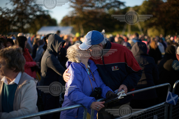 Around 70,000 people celebrate open-air mass at Bellahouston park, Glasgow for the visiting Pope Benedicte XVI on the first state visit to Scotland...Sharing the 'sign of peace' after prayers.