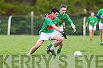 Shane Joy of Beal contest the loose ball with Paudie Galvin of Finuge in the Bernard O'Callaghan Memorial Senior Football Championship Final last Sunday in Ballylongford.