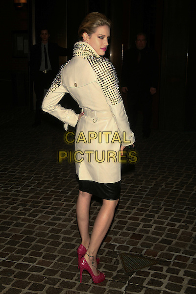 "JULIE ORDON.The Special Screening of ""Cracks"" held at the Tribeca Grand Hotel, New York, NY, USA..March 16th, 2011.full length white mac jacket gold studs studded red pink peep hand on hip back behind rear looking over shoulder dress.CAP/LNC/TOM.©TOM/LNC/Capital Pictures."