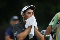 Louis Oosthuizen (RSA) mops his face clean of the humidity and shot a 68 during the Final Round to finish T2 at the 2014 Maybank Malaysian Open at the Kuala Lumpur Golf & Country Club, Kuala Lumpur, Malaysia. Picture:  David Lloyd / www.golffile.ie