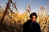 """A Salvadoran immigrant, hiding in the corn field, waits near the railroad track to climb up the cargo train passing through the train station in Huehuetoca, Mexico, 7 November 2014. Between 2010 and 2015, the US and Mexico have apprehended almost 1 million illegal immigrants from El Salvador, Honduras, and Guatemala. While the economic reasons remain the most frequent motivation for people from Central America to illegally immigrate to the US, thousands of Salvadorans, Guatemalans, and Hondurans, many of them minors, seek asylum in the US due to the thriving crime and gang-related violence in their region (known as the Northern Triangle). Taking an exhausting and risky journey, riding thousands of miles atop the cargo trains, facing a physical danger and extortion from the organized crime groups that control migrant routes, the """"undocumented"""" still flee to the US, looking for their American dream."""