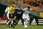 15 May 2004: Referee Ricardo Salazar (yellow) whistles a foul on Bryan Namoff (26) for grabbing Davy Arnaud (22) in the second half. DC United defeated the Kansas City Wizards 1-0 at RFK Stadium in Washington, DC during a regular season Major League Soccer game..