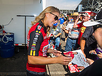 Sep 23, 2016; Madison, IL, USA; NHRA driver Leah Pritchett, pilot of the Papa Johns Pizza sponsored top fuel dragster of Don Schumacher Racing signs autographs for fans in the pits during qualifying for the Midwest Nationals at Gateway Motorsports Park. Mandatory Credit: Mark J. Rebilas-USA TODAY Sports