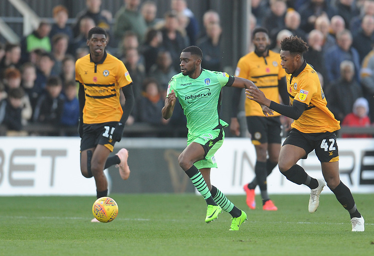 Colchester United's Kane Vincent-Young under pressure from Newport County's Antoine Semenyo<br /> <br /> Photographer Kevin Barnes/CameraSport<br /> <br /> The EFL Sky Bet League Two - Newport County v Colchester United - Saturday 17th November 2018 - Rodney Parade - Newport<br /> <br /> World Copyright © 2018 CameraSport. All rights reserved. 43 Linden Ave. Countesthorpe. Leicester. England. LE8 5PG - Tel: +44 (0) 116 277 4147 - admin@camerasport.com - www.camerasport.com