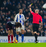 Brighton & Hove Albion's Glenn Murray is shown a yellow card by  referee Anthony Taylor after a foul on Arsenal's Matteo Guendouzi <br /> <br /> Photographer David Horton/CameraSport<br /> <br /> The Premier League - Brighton and Hove Albion v Arsenal - Wednesday 26th December 2018 - The Amex Stadium - Brighton<br /> <br /> World Copyright © 2018 CameraSport. All rights reserved. 43 Linden Ave. Countesthorpe. Leicester. England. LE8 5PG - Tel: +44 (0) 116 277 4147 - admin@camerasport.com - www.camerasport.com