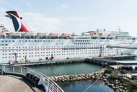 Carnival Imagination cruise ship docked next to The Queen Mary, Long Beach, California. Greater Los Angeles area.