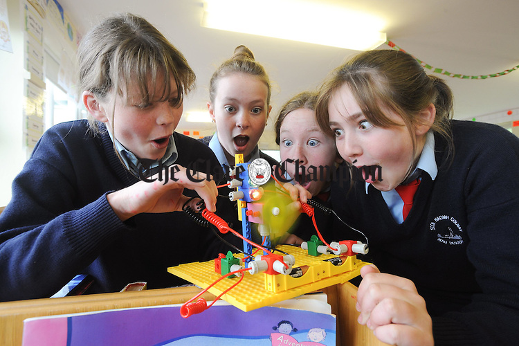 Aisling Rock, Clína Harney Aine Flaherty and Anna Clancy working on a science and technology project  at Tierneevin National School. Photograph by John Kelly.