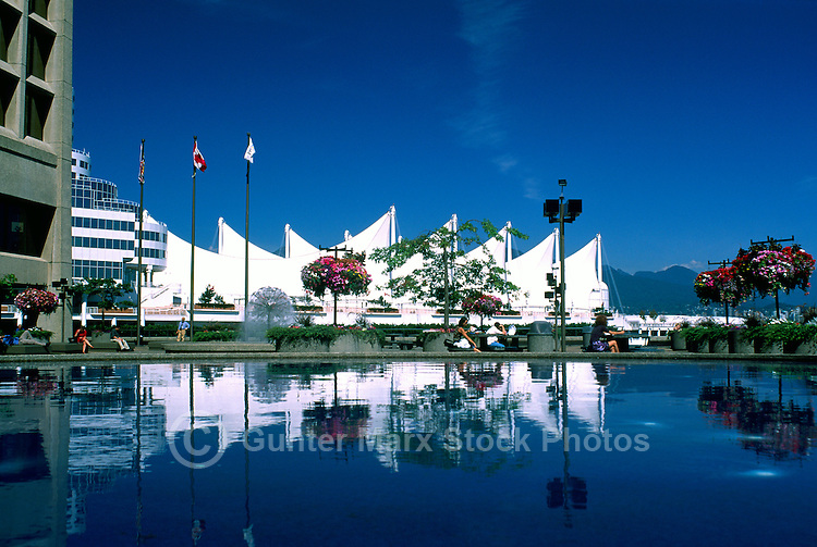 "Vancouver, BC, British Columbia, Canada - Sails of ""Canada Place"" Trade and Convention Centre reflecting in Water Fountain at ""Granville Square"", Summer"