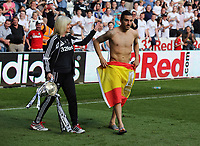 Pictured: Chico Flores of Swansea (R) wears a spanish flag he was just given by a fan, after he tossed his shorts to the East stand. Sunday 19 May 2013<br />