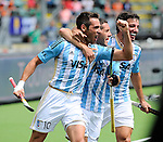 The Hague, Netherlands, June 15: Matias Paredes #10 of Argentina is congratulated by Agustin Mazzilli #26 of Argentina and Manuel Brunet #24 of Argentina during the field hockey bronze match (Men) between Argentina and England on June 15, 2014 during the World Cup 2014 at Kyocera Stadium in The Hague, Netherlands. Final score 2-0 (0-0)  (Photo by Dirk Markgraf / www.265-images.com) *** Local caption ***