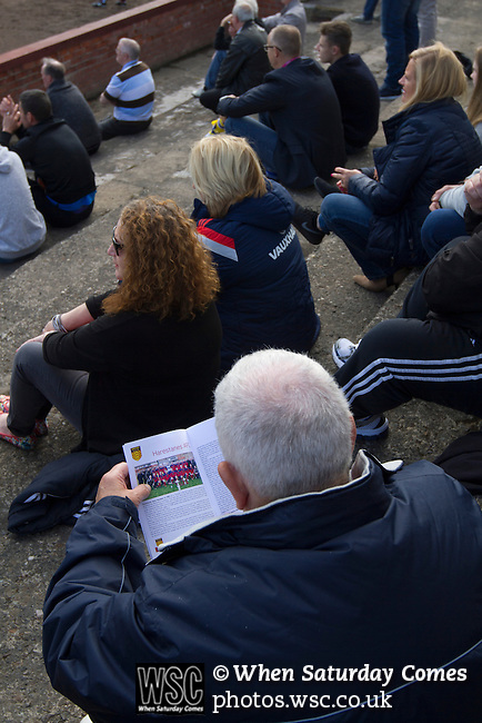 Harestanes AFC v Girvan FC, 15/08/2015. Scottish Cup preliminary round, Duncansfield Park. A spectator reading the match day programme as Harestanes AFC take on Girvan FC in a Scottish Cup preliminary round tie, staged at Duncansfield Park, home of Kilsyth Rangers. The home team were the first winners of the Scottish Amateur Cup to be admitted directly into the Scottish Cup in the modern era, whilst the visitors participated as a result of being members of both the Scottish Football Association and the Scottish Junior Football Association. Girvan won the match by 3-0, watched by a crowd of 300, which was moved from Harestanes ground as it did not comply with Scottish Cup standards. Photo by Colin McPherson.
