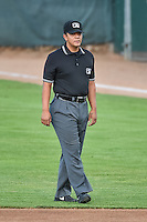 Umpire Luis Hernandez handles the calls on the bases during the Pioneer League game between the Ogden Raptors and the Great Falls Voyagers at Lindquist Field on July 16, 2015 in Ogden, Utah. Ogden defeated Great Falls 5-2. (Stephen Smith/Four Seam Images)