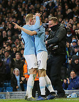 Manchester City's Phil Foden celebrates with team-mate Oleksandr Zinchenko after scoring his sides sixth goal <br /> <br /> Photographer Rich Linley/CameraSport<br /> <br /> UEFA Champions League Round of 16 Second Leg - Manchester City v FC Schalke 04 - Tuesday 12th March 2019 - The Etihad - Manchester<br />  <br /> World Copyright © 2018 CameraSport. All rights reserved. 43 Linden Ave. Countesthorpe. Leicester. England. LE8 5PG - Tel: +44 (0) 116 277 4147 - admin@camerasport.com - www.camerasport.com