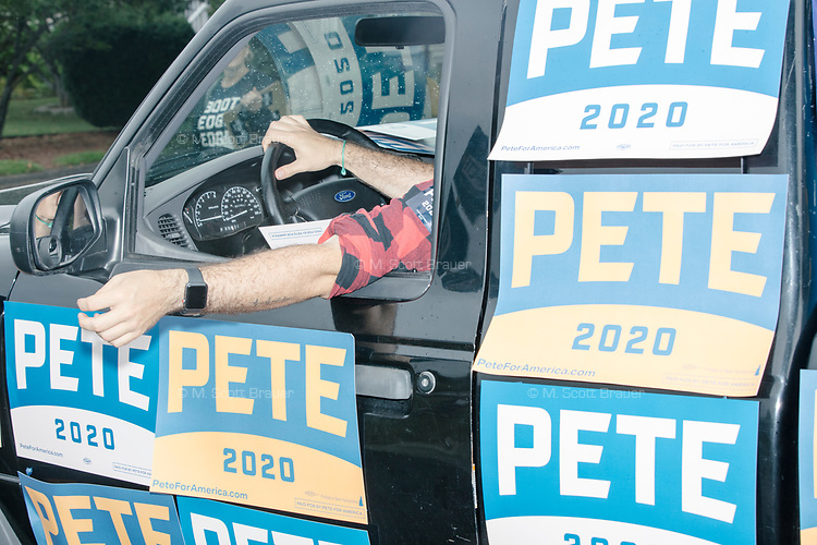 Supporters of Democratic presidential candidate and South Bend, Ind., mayor Pete Buttigieg take part in the Labor Day Parade in Milford, New Hampshire, on Mon., September 2, 2019. Candidates Bernie Sanders and Vermin Supreme were the only candidates who marched in the parade this year.