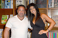 """CORAL GABLES, FL - JUNE 09: Joe Giudice and Teresa Giudice, of tv's The Real Housewives of New Jersey, seen together as she promotes and signs copies of her new book,  """"Fabulicious!: Fast & Fit"""" at Books and Books on June 9, 2012 in Coral Gables, Florida. © mpi1/MediaPunch Inc. NORTEPHOTO.COM"""