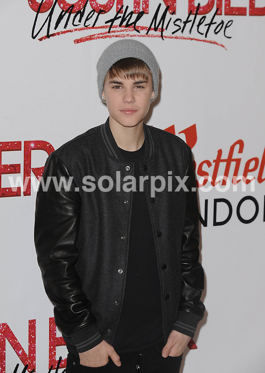 **ALL ROUND PICTURES FROM SOLARPIX.COM**                                             **WORLDWIDE SYNDICATION RIGHTS**                                                                                  Caption: American pop singerJustin Bieber arrives to turn on the Westfield Christmas Lights at Westfield Shopping Centre, White City in the Uk                                                                             This pic: Justin Bieber                                                                                             JOB REF: 14162       LNJ       DATE:07.11.2011                                                            **MUST CREDIT SOLARPIX.COM OR DOUBLE FEE WILL BE CHARGED**                                                                      **MUST AGREE FEE BEFORE ONLINE USAGE**                               **CALL US ON: +34 952 811 768 or LOW RATE FROM UK 0844 617 7637**