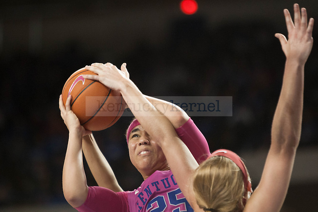 Junior guard Makayla Epps (25) shoots a ball over a defender during the game against the Arkansas Razorbacks on Sunday, February 21, 2016 in Lexington, Ky. Kentucky won the game 77-63. Photo by Hunter Mitchell | Staff