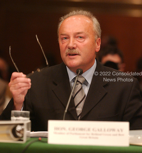 "Washington, D.C. - May 17, 2005 -- George Galloway , Member of Parliament for Bethnal Green and Bow , Great Britain, testifies before the United States Senate Committee on Homeland Security and Governmental Affairs Permanent Subcommittee on Investigations hearing on ""Oil For Influence: How Saddam Used Oil to Reward Politicians Under the United Nations Oil-for-Food Program"" in Washington, D.C. on May 17, 2005.  .Credit: Ron Sachs / CNP"