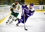 2 February 2020: Holy Cross Crusader Defender Emma Lange, a Sophomore from Cheshire, CT, keeps the puck away from University of Vermont Catamount Forward Lily Humphrey, a Freshman from Huntington Beach, CA, in second period action at Gutterson Fieldhouse in Burlington, Vermont. The Lady Cats rallied in the 3rd period to tie the Crusaders 2-2 in NCAA Women's Hockey East play. Mandatory Credit: Ed Wolfstein Photo *** RAW (NEF) Image File Available ***