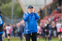 Grimsby manager Russell Slade claps the travelling fans at full time of the Sky Bet League 2 match between Cheltenham Town and Grimsby Town at the The LCI Rail Stadium,  Cheltenham, England on 17 April 2017. Photo by PRiME Media Images / Mark Hawkins.