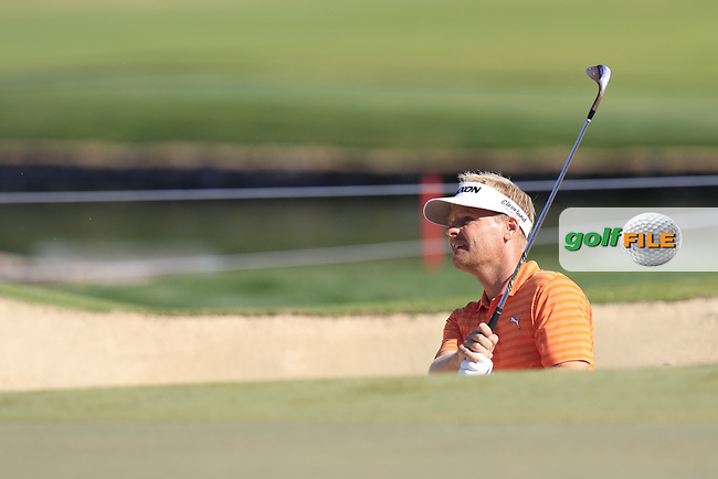 Soren Kjeldsen (DEN) chips from a bunker at the 14th green during Sunday's Final Round of the 2016 Omega Dubai Desert Classic held at the Emirates Golf Club, Dubai. 7th February 2016.<br /> Picture: Eoin Clarke | Golffile<br /> <br /> <br /> All photos usage must carry mandatory copyright credit (&copy; Golffile | Eoin Clarke)