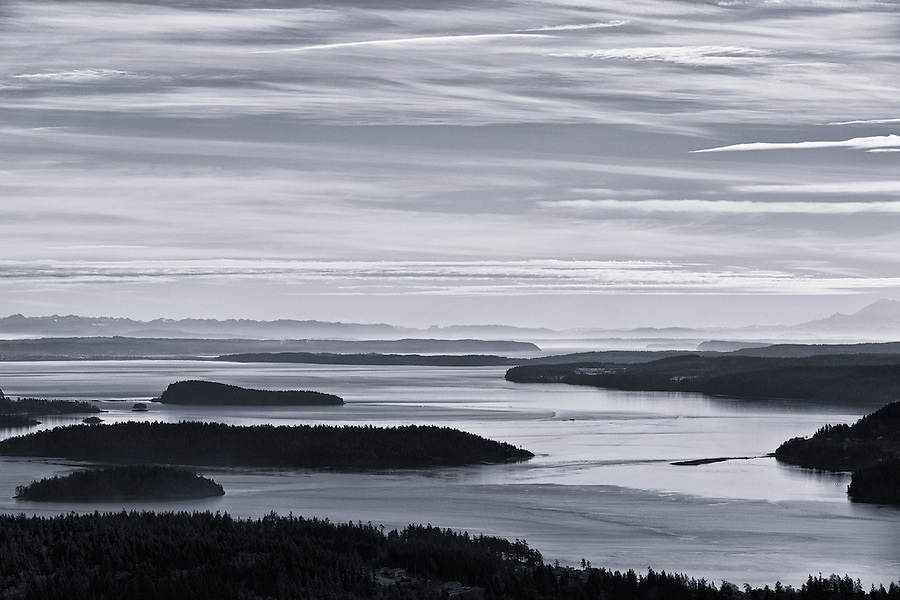 Kiket, Skagit, and Hope islands are seen from the Mt. Erie viewpoint on Fidalgo Island, Washington State with Mt. Rainier in the distance on the right.
