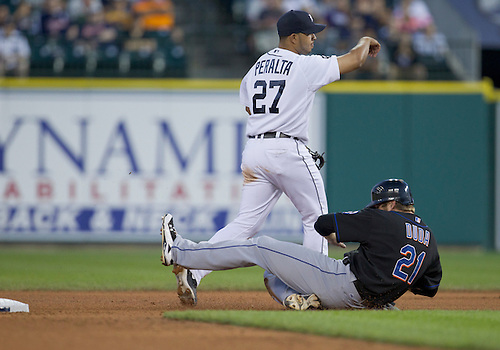 June 28, 2011:  Detroit Tigers shortstop Jhonny Peralta (#27) turns the double play as New York Mets outfielder Lucas Duda (#21) slides into base during MLB game action between the New York Mets and the Detroit Tigers at Comerica Park in Detroit, Michigan.  The Mets defeated the Tigers  14-3.