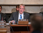 """United States Senator Dan Sullivan (Republican of Alaska) hears testimony before the United States Senate Committee on Armed Services Subcommittee on Readiness and Management Support during a hearing titled """"US Air Force Readiness"""" on Capitol Hill in Washington, DC on Wednesday, October 10, 2018.<br /> Credit: Ron Sachs / CNP"""