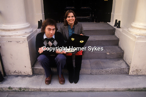 Andrew Lloyd Webber and Sarah Hugill his first wife sitting on the steps of their London home. Sarah with a Cats Musical promotional material. Circa 1980s