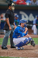 Tre Todd (11) of the Ogden Raptors on defense against the Great Falls Voyagers at Lindquist Field on August 21, 2018 in Ogden, Utah. Umpire Edgar Suarez handles the calls behind the plate.  Great Falls defeated Ogden 14-5. (Stephen Smith/Four Seam Images)