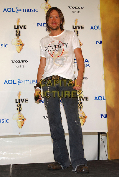 KEITH URBAN.Live 8 Pressroom - Philadelphia, Pennsylvania.Live 8 is a series of nine concerts on four continents the same day to raise awareness to call for an end to extreme poverty in Africa.  .July 2nd, 2005.Photo Credit: George Shepherd/AdMedia.full length jeans denim poverty t-shirt t shirt logo slogan.www.capitalpictures.com.sales@capitalpictures.com.© Capital Pictures.