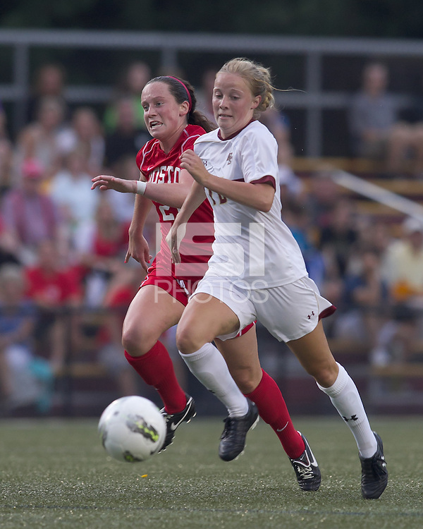 Boston College midfielder Julia Bouchelle (12) on the attack as Boston University midfielder Megan McGoldrick (21) defends. After 2 complete overtime periods, Boston College tied Boston University, 1-1, after 2 overtime periods at Newton Soccer Field, August 19, 2011.