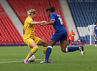 Women's Olympic Football match France v Sweden on 3.8.12...Annica Svensson of Sweden and Marie-Laure Delie of France, during the Women's Olympic Football match between France v Sweden at Hampden Park, Glasgow...............