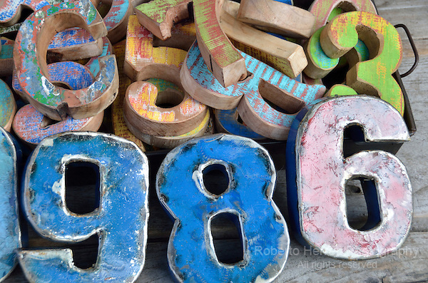 A pile of coloured wooden numbers.