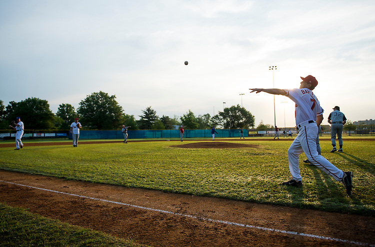 UNITED STATES - MAY 16: Rep. Lou Barletta, R-Pa., right, warms up with the Republicans' Congressional baseball team during practice in Alexandria, Va., on Thursday morning, May 16, 2013. (Photo by Bill Clark/CQ Roll Call)