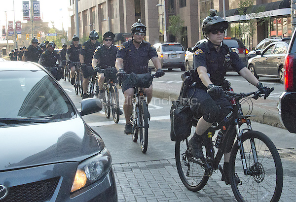 Police officers on bicycles ride down Euclid Avenue about two blocks from the Quicken Loans Arena, site of the 2016 Republican National Convention in Cleveland, Ohio on Saturday, July 16, 2016.<br /> Credit: Ron Sachs / CNP/MediaPunch<br /> (RESTRICTION: NO New York or New Jersey Newspapers or newspapers within a 75 mile radius of New York City)