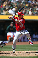 OAKLAND, CA - MARCH 31:  Mike Trout #27 of the Los Angeles Angels bats against the Oakland Athletics during the game at the Oakland Coliseum on Sunday, March 31, 2019 in Oakland, California. (Photo by Brad Mangin)