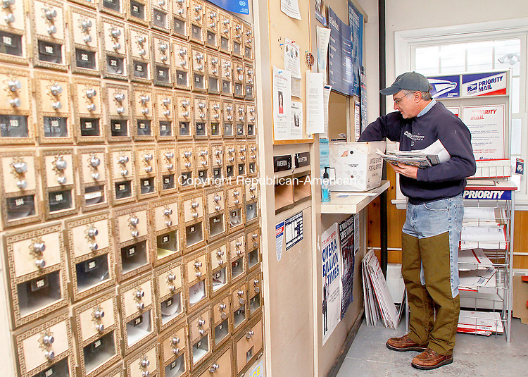 RIVERTON, CT- 05 JANUARY 2013 010513JW02 - Jim Buchok collects his mail from the Riverton Post office Saturday morning. Buchok said that his trip to the post office would change from the 1/8 of a mile to 5.6 miles if the Riverton office closed and he had to get his mail from Winsted as part of a Post Office re-organization plan..Jonathan Wilcox Republican American..