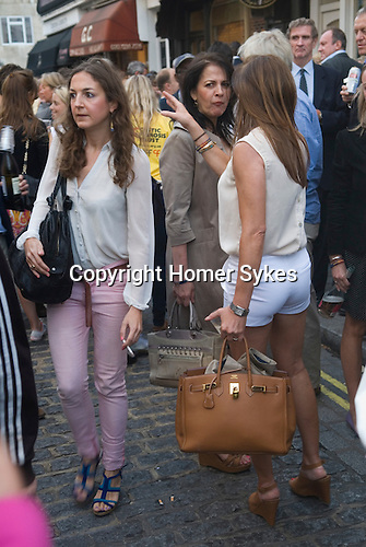 Motcombe Street Belgravia London UK. Summer Street Party . Woman wearing hot pants