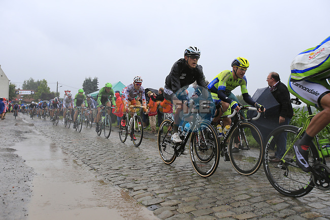 Riders including Nicolas Roche (IRL) Tinkoff-Saxo and Matteo Trentin (ITA) Omega Pharma-Quick Step tackle the1st cobbled sector 9 from Gruson to Crossroads de l'Arbe during Stage 5 of the 2014 Tour de France running 155.5km from Ypres to Arenberg. 9th July 2014.<br /> Picture: Eoin Clarke www.newsfile.ie