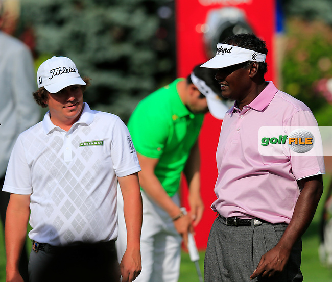 Jason Dufner (USA) chats to Double PGA Champion Vijay Singh (FIJ) during Monday's Practice Day of the 95th PGA Championship 2013 held at Oak Hills Country Club, Rochester, New York.<br /> 5th August 2013.<br /> Picture: Eoin Clarke www.golffile.ie