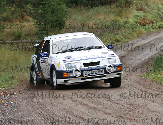Jimmy McRae / Sir Chris Hoy at Junction 1 on Special Stage 1 Sophia Woods on the Colin McRae Forest Stages Rally 2013, Round 8 of the RAC MSA Scotish Rally Championship which was organised by Coltness Car Club and based in Aberfeldy on 5.10.13.