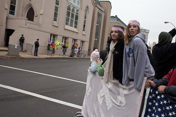 December 11, 2010. Raleigh, NC..(left to right) Mary Beth Eisenstadt and Lizzie Baer joined the counter protesters near the funeral of Elizabeth Edwards to combat members of the Kansas based Westboro Baptist Church who picketed the funeral.. A funeral was held at the Edenton Street United Methodist Church to honor the life of Elizabeth Edwards, the estranged wife of former Democratic presidential candidate John Edwards, who died after an 6 year battle with breast cancer..
